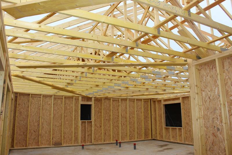 fabrication d'une maison en ossature bois avec enduit en finition extérieur